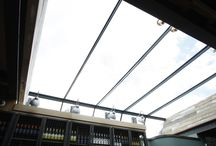 Project: Beechwood Bar / Structural roof glazing to rooftop bar in Beaconsfield. The large structural glass units were supported using minimal steel T sections