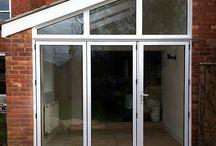 Cheltenham 2015 / White Bi-folding Door with shaped top light