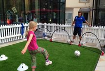 Woking FC / Woking FC have been joining Woking Shopping on The Lawn, Jubilee Square this Summer to show off their football skills and teach them to Woking's children.