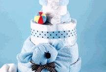 too cute diaper cakes / by Pat Crosland