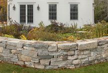 Stone Walls / A natural stone wall will embellish the look of your property while harmoniously connecting your house design with nature. These structures can create charming raised flower beds, natural garden backdrops, boundary markers, driveway ramps, or purely serve as decoration.