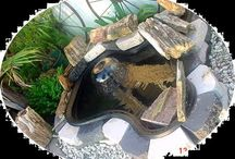 Our customer's ponds / These are ponds that our customers submitted to our site. Many of them are customers first attempts at ponds. Some have koi and some new not, some with pond plants and some not. All of them are original and creative.