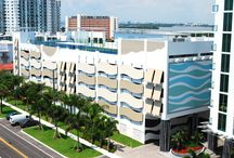 "Eloquence on the Bay / These are contemporary and innovative awnings that are installed on the façade of the parking garage/recreation area of a 5-star condominium.   (26) ""wave"" panels approximately maximum of 8'-2""h x maximum of 26'-6"" in width.  (32) awnings 8'-3"" h x 6' to 4'-3""in width.  The design of the awnings harmonizes with this vibrant cosmopolitan condominium."
