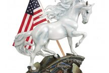"""Summer 2016 Painted Ponies / Introducing """"Unconquered,"""" a magnificent white stallion that stands as an inspiring and patriotic representation of the indomitable American spirit...  MORE Summer 2016 Painted Ponies will be announced on June 15, 2016, so be sure to check back!"""