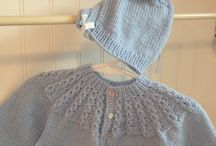 Baby Gifts from Little White Cottage / Adorable handmade baby sweaters and matching hats. These are designed exclusively for Little White Cottage. They come in 3-6 month sizes and are available in White, Baby Blue, Soft Pink. The set is $35.00.