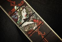 Lulu / 'Lulu' - a custom ordered inlay project, designed together with the client. Theme inspired by Art Nouveau, Alfons Mucha's art and Brigitte Bardot. Materials used: White and gold mother-of-pearl, various types of abalone seashell, reconstructed stone materials and padauk tree. Engraving technique and style inspired by my teacher and master of engraved inlay, William-Grit Laskin.