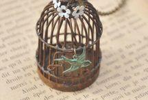 Necklaces<<