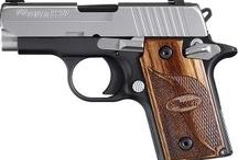 Beautiful handguns.