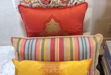 Designer Throw Pillows / The accent of a throw pillow, guaranteed to bring new life to any chair, couch or bed setting.  We have a huge selection everything from bright and colorful, to neutral and understated.  We can help you find the perfect one!