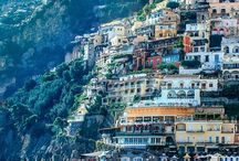 "Positano / Positano was a port of the Amalfi Republic in medieval times, and prospered during the sixteenth and seventeenth centuries. It began to attract large numbers of tourists in the 1950s, especially after John Steinbeck published his essay about Positano in Harper's Bazaar in May, 1953: ""Positano bites deep"", Steinbeck wrote. ""It is a dream place that isn't quite real when you are there and becomes beckoningly real after you have gone."""