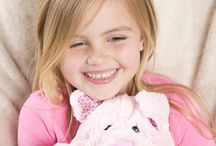 This little piggy went home with you! / Who doesn't love pigs? Those cute pink farmyard animals that go oink! Kids certainly love them and our piggy range of warmers make great gifts for pig lovers, big and small. #pigs #piggifts #noveltypigs