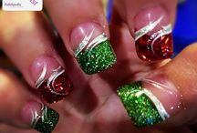 Christmas Nails... definitely wouldn't do all my nails like this. But I do love the glitter tip with a swirl over