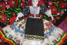 China Dolls / Beautiful porcelain dolls all dressed up in Hungarian folk wear.
