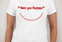 """Wear your Happiness 2016  Humor Month / April 1st begins National Humor Month.   Start by sharing your mirthful laughter and show the world your support of the Healing Headbands Project with the 2016 """"Wear your Happiness"""" T-Shirt Woman's, Men's and children sizes.  While quantities last.  LAUGH CREATE HEAL"""
