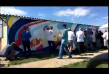 Community murals / Murals I laid out as a giant paint by numbers and public volunteers painted in