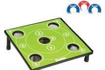 Washer Toss / Try to get the washers in the hole or at least within the wooden sides with this unique new game of Washer Toss. Similar to bean bag toss, the goal is to get the washers into the center of the board to get the most points possible. - See more at: http://franklinsports.com