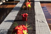 Event at Stoneburner Olympic Rooftop Pavilion c. Juniper Flowers / Flowers for kings table at Stoneburner Designed by Juniper Flowers