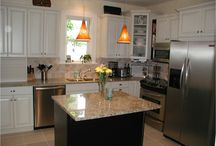 Kitchen Remodel Columbus Ohio / This Columbus, Ohio kitchen remodel uses granite, tile, stainless steel appliances and juxtaposes white cabinets with a black island.