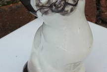 Cat Figurines / by Rebecca Cunningham
