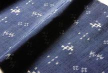 Kasuri / Traditional Japanese Kasuri fabrics are created using a method of weaving together threads that have a pattern dyed into them. The patterns are created using a resist dyeing technique known as Ikat. This resist dying technique is combined with traditional indigo dye making to create the distinctive blurry edge patterns that make Kasuri textiles so unique and beautiful.