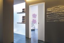 Pocket Doors / Save space with Pocket Doors. The framework forms part of the wall and allows your door to slide effortlessly inside the  wall, freeing up all the space that the door arc normally takes out of service.