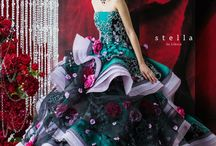 Breathtaking dark aqua green wedding dress with magenta roses