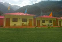 Yamunotri Cottages / The luxury at the foothills of Himalaya's lies in the form of Yamunotri cottages that is located in the Kharsali village between the river Yamuna and Hiranyabahu at an altitude of 2500 meters or 8250 feet above the sea level. This cottage is adjoining the only Helipad facility in Yamunotri Cottages surrounded by breathtaking beauty, magnificent snow capped Himalayan Mountains, wonderful meadows together with the conifer trees and also stepping paddies.
