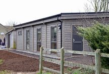 Classrooms - contemporary / Our modular classrooms are easily transported and can be erected in a matter of days. With a striking contemporary look, they are economical to run and the solid log construction offers a calm, echo-free learning environment.