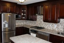 Dark Cherry Coloured Custom Kitchen Cabinets with Granite Countertop / Solid Wood Kitchen Cabinets with White Granite Countertop manufactured by Millo Kitchens and Baths