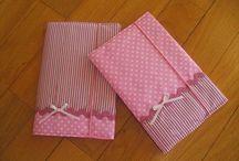 Agendas e livros forrados a tecido