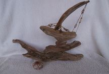 Driftwood Boats / Small pieces of driftwood crafted into boats.
