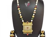 Rich and Traditional Pearl Necklace Set in Bold Pendant at Rs. 5,900