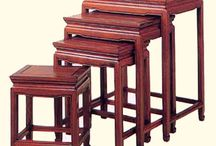 Asian Rosewood Chairs and Accessories / Each one is 100% hand crafted by masterful Chinese artisans. Sturdy tongue and groove construction. Delicate beveling. Smooth as silk finish. Feel the warmth of the deep, rich wood grains on these decorative pieces. Add companion pieces to your new tables from our wide array of solid rosewood Oriental furniture. Get yours today.
