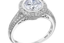 Let Me See Your Halo! / Engagement rings with a halo feature small round diamonds that surround the center diamond, accenting it and adding additional sparkle. Some halos can even give the illusion of a bigger center diamond!