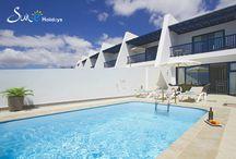 Residencial Cortijo Mar - Villa Faro Puerto Calero - Lanzarote - Spain / These attractive, three story, three bedroom villas are located in the exclusive marina of Puerto Calero in a frontline position with fabulous views to the sea.