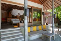Six Senses Laamu /  An eco-friendly luxury resort surrounded by clear turquoise water and white sandy beaches.