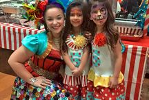 Circus Girl by Happily Ever Laughter / When our performers transform into our Circus Girl character for birthday parties and corporate events, they add the burst of color that makes any event over the top! When we created her, we visualized the traditional clown, and then made the costume a little more flattering to wear. We also abandoned the full face paint and added an elaborate headpiece instead. Take a peek at our board to see all of the different versions of our Circus Girls at parties all over California.