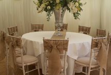 Burlap Sashes at a Country Chic Wedding / Beautiful Burlap sashes on Chivari Chairs in a marquee supplied by www.suffolkmarquees.com