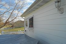 Hardie Arctic White with Maintenance Free Covered Deck (Illinois) / This is an Siding Remodel Project in Granite City, Illinois.