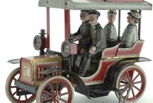 tin toy cars and motorcycles