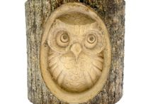 Timber-Treasures small owl in log / One of Timber-Treasures best sellers, the tree owl is a perfect addition to any garden. Treated with teak oil to make it weatherproof, each owl is fixed with a metal hanger for fixing on display.  The owl is hand carved into a Jemphinis log. The composition of the bark and its native lichen,along with its hand carved nature, means that no two carvings are the same, making each owl carving truly unique. Dimensions: 10 x 10 x 6 cm* *handmade disclaimer