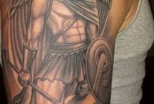 Shoulder shield tattoo