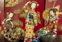 Chinese Porcelain Dolls / The finest of detail and intricate design.. Hand Painted Shi Wan porcelain dolls.
