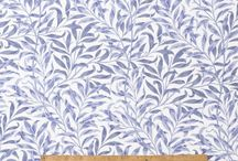 "William Morris Willow Bough / This Licenced William Morris Willow Bough Design was first designed in 1887. It was first produced as a wallpaper design which William's daughter, May Morris used to decorate her bedroom before being adapted for fabric in 1895 when it was block printed in Merton Abbey. May wrote about the deisgn, ""We were walking one day by our little stream that runs into the Thames and my father pointed out the detail and soon after the paper was done."" We stock this design in both blue and green."