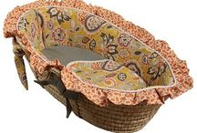 Moses Baskets / Just the right size for sharing Mom and Dad's room, a Moses Basket could be the perfect item for baby's first few months! Moses Baskets are available in many fun colors and prints with a rocking stand to keep baby always nearby.