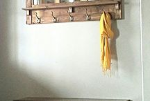 Wooden mirror with coat hooks