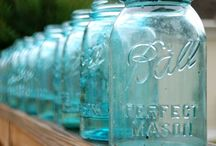 Mason Jars and Twinkling Lights / Oh!  I just love decorating with mason jars!  I love the old ones.  The aqua colored jars are my favorite.  Nothing is prettier than a vase of flowers casually placed in mason jar & oh! how pretty is a twinkling candle from an old mason jar...epitome of romance!