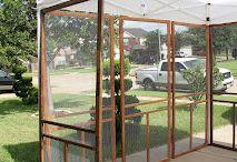 screen doors around a tent gazebo