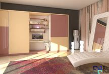 blushing-peach Wardrobe Design / Bright appearance for the wardrobe given by the mixture of peach and blush color with glossy finish . Accompanied with study table in the middle .