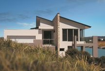Latitude 37: Helsal Point, Safety Beach Custom Home / This is a custom waterside home that won the 2015 'HIA Eastern Victoria Custom Built Home $700,000 - $1 Million' award. Located in Safety Beach, Victoria Australia, this home was designed to overcome a 2.5m benched site with water on two sides. The unique design has created a split level home that maximises natural light as well as maximising views of the water.